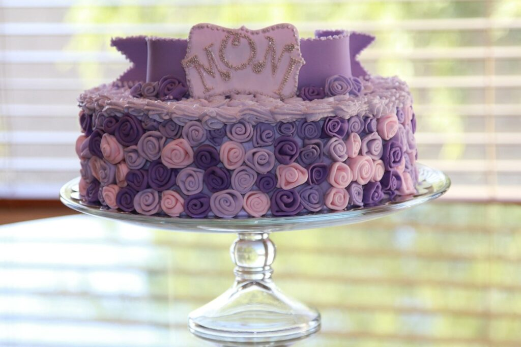 A purple cake with a floral design